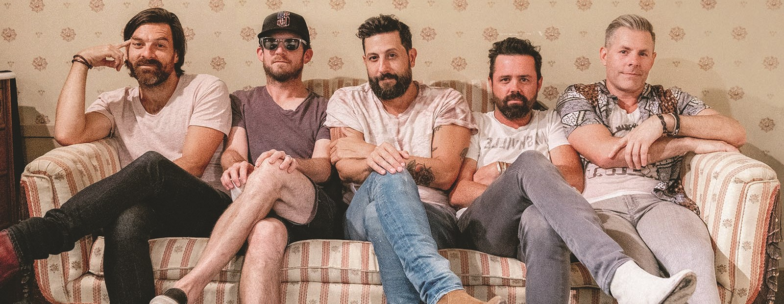 Old Dominion band members on a couch