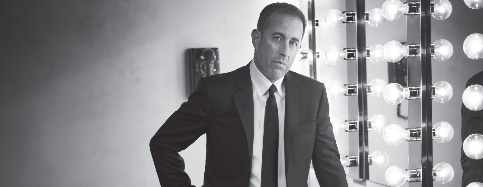 Jerry Seinfeld standing in dressing room