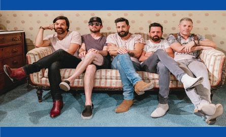 Members of Old Dominion band sitting on a couch