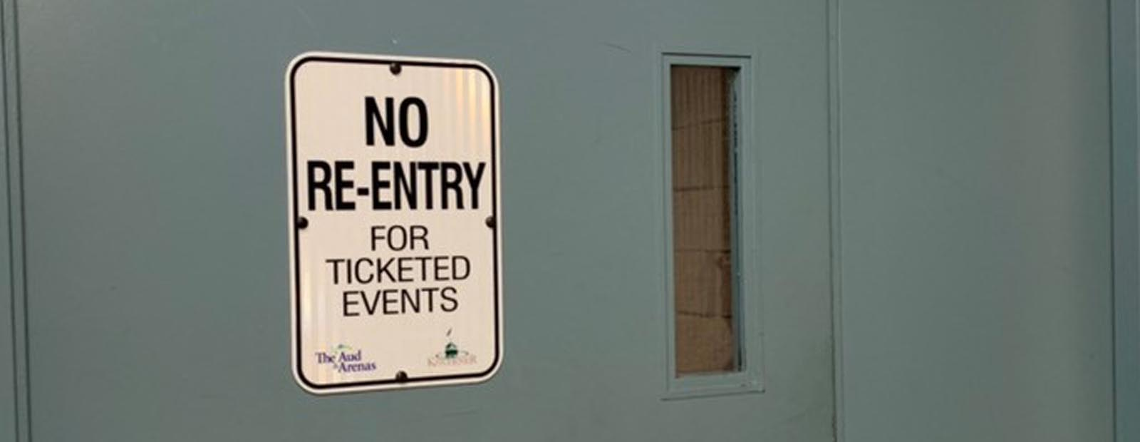 No re-entry sign for ticketed events sign on door